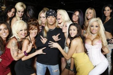 rich and famous rockstar with groupies